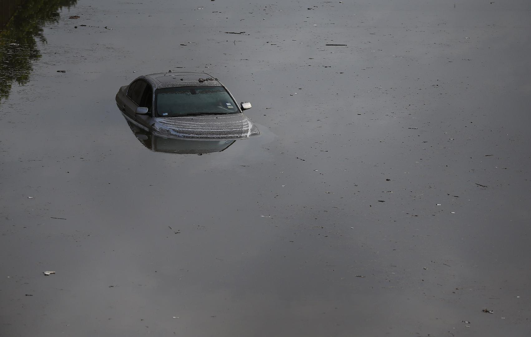 You're Trapped in Your Car in Rising Floodwaters: Here's What to Do